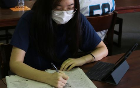 Junior Erica Choi studies in the library for her upcoming SATs. Hebron will have a free, in-person SAT for seniors on Oct. 27 because seniors have limited testing availability due to COVID-19.