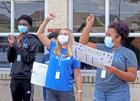 "Student Council seniors Dexter Mitchell, Sydney Stafford and Tamia Hatcher shout for a video of the ""Hawk Pride Never Dies"" chant. The video will be a clip in the virtual homecoming pep rally to be held on Nov. 13."