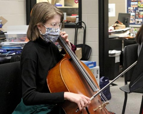 Senior Marianna Rooks plays the cello during orchestra practice. Many of the concerts, such as the cluster concert with the middle schools, have been cancelled due to COVID-19 restrictions.