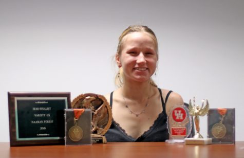 "Senior Kasia Drewniak poses with awards she has received during her time in debate. Drewniak started debate her freshman year. ""I have a Polish mom and she was looking at stuff that would look good on my college applications when I was in eighth grade,"" Drewniak said. ""She [said] 'Kasia, you talk way too much, you should join debate.' So that's what I did. And then I grew to love it a lot, which is crazy because I wasn't even going to do it if it wasn't for that."""