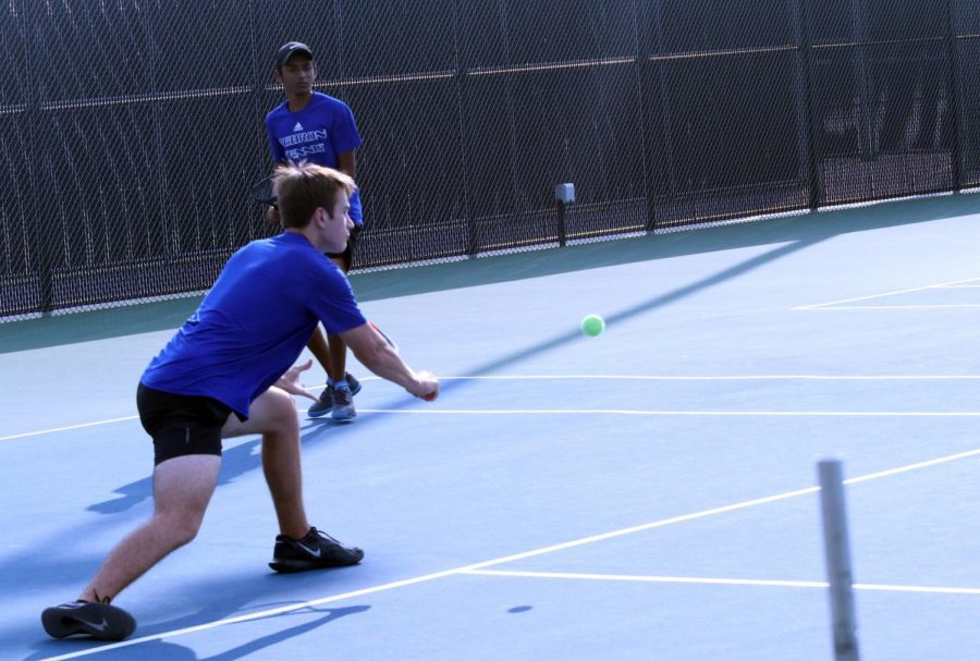 "Senior Robert Herrera reaches out to return the ball in his doubles match. Herrera and Agarwal faced the top pairing from Coppell. ""The match was good in the first set; we really competed with them,"" Herrera said. ""In the second set they stepped up their game. We had some good points but it came down to a few points that lost us the match."""