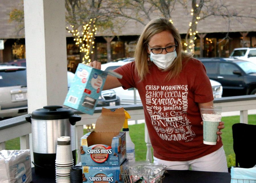 Volunteer Angela Bruner makes a cup of hot chocolate for a donator. Bruner volunteered with Metrocrest, an organization that focuses on assisting families, individuals and senior adults who are coping with crisis situations, need help stabilizing their lives or who require support to live independently.