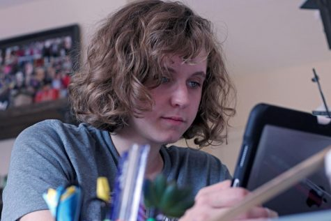 Junior Claire Clausen chose to do virtual school this year. She works on school work from her room Thursday night.
