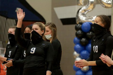 Senior Brooke Nichols waves to the crowd as her name is called before the senior night game begins. Nichols has played on varsity all four years of high school and committed to play at Old Dominion University next year in college.
