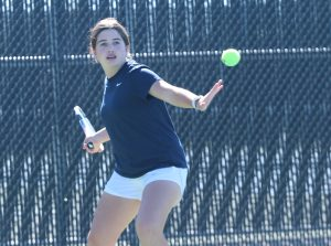 Freshman Macie Snyder returns the ball during tennis practice on Oct. 30. The tennis season ended on Oct. 20 with a game against Lewisville, and will start up again late next semester.