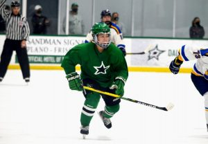 "Senior Bronwyn Khangsar skates across the ice during a hockey game. She is one of the team captains and plays defense for the Dallas Stars Elite Girls hockey team. ""[It's difficult] constantly being motivated to improve,"" Khangsar said. ""There's so many ways to get better and be the best that you can be."""