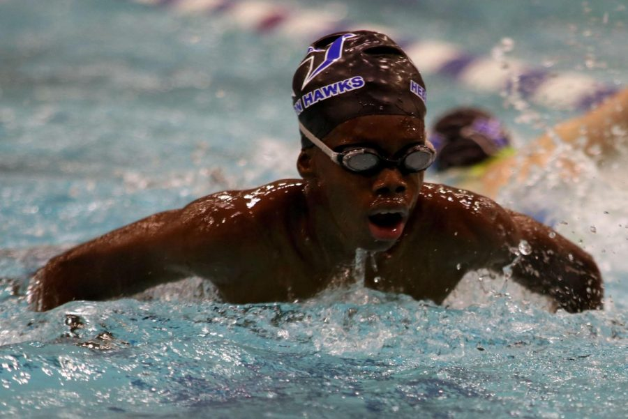 Freshman Nigel Duplessis practices the breaststroke during morning swim practice at the Eastside Aquatic Center. The team practices every day at 6:15 a.m. starting with dryland workouts.