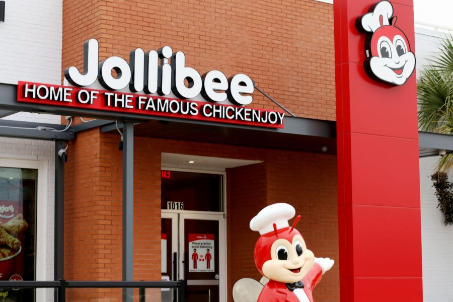 Jollibee%27s+mascot%2C+named+Jollibee%2C+stands+outside+the+restaurant+to+greet+guests.+Jollibee+opened+in+Plano+in+August.++