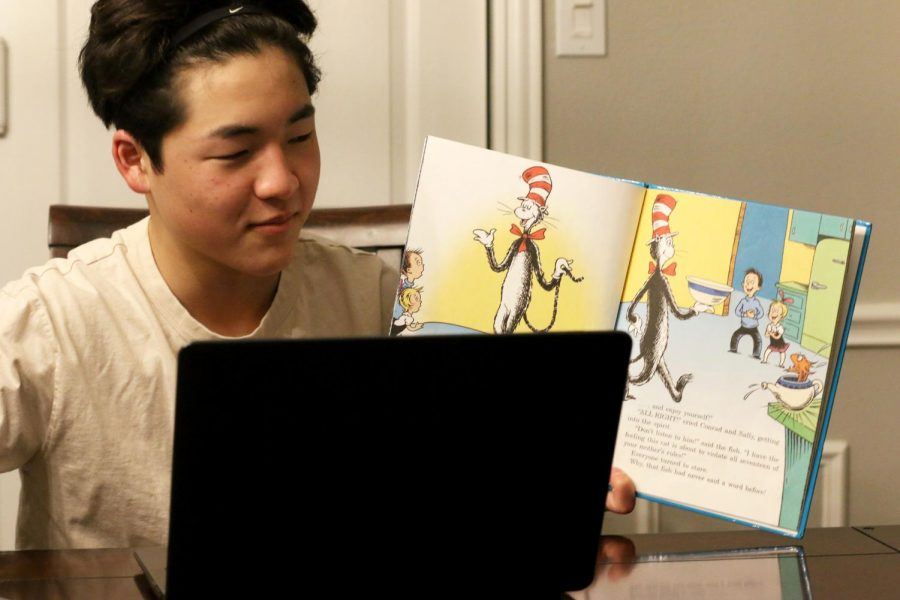 A student is reading to younger children over a virtual call. Since volunteering opportunities are limited due to COVID-19, students are finding creative ways to help their community through programs like Reading Partners and Vogel Alcove, both of which validate service hours.