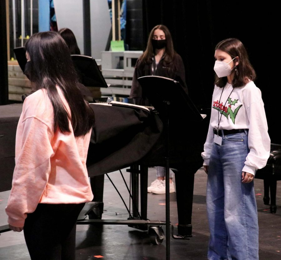 Choir practices in the Auditorium during third period in preparation for the first in-person concert. The choir has been performing at different times in order to maintain proper COVID-19 safety protocols.