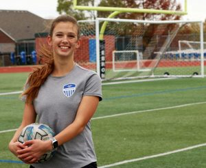 "Junior Sydney Japic stands with a ball on the soccer field after practice. Sydney was unable to play high school soccer the past two years. ""I'm looking forward to starting to play high school games because I've never played high school soccer before,"" Japic said. ""This is my first year."""