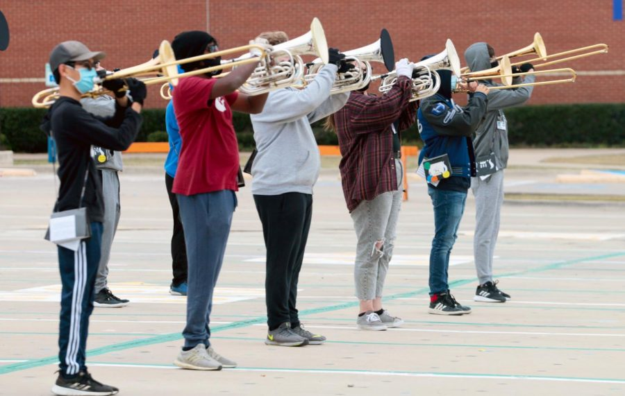 Concert band rehearses choreography for their upcoming competition outside during third period. Due to the pandemic, the band's show is shorter than previous years.