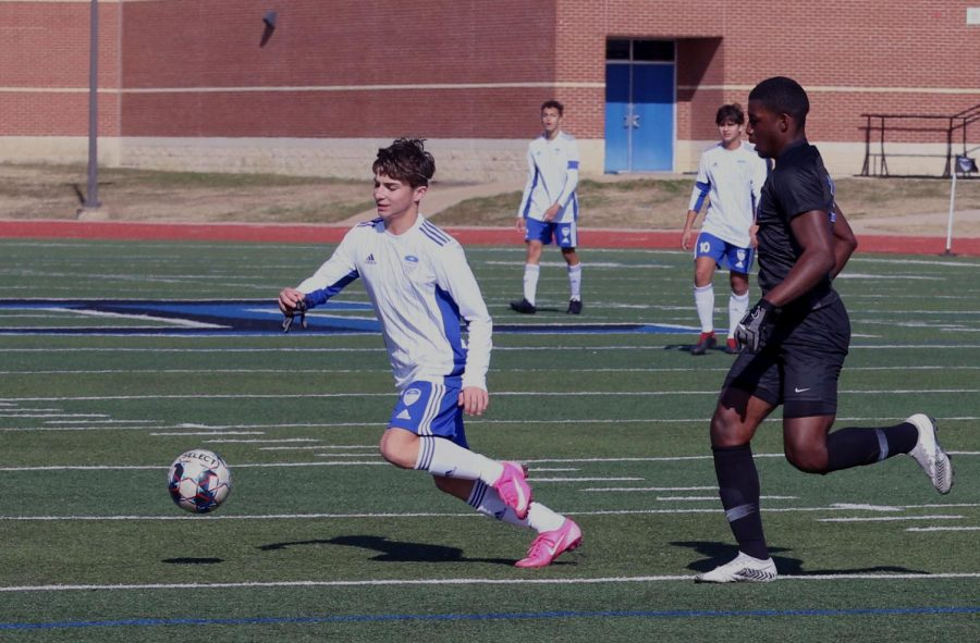 Sophomore midfielder Luke Dean races to the ball. Dean scored a goal off a volley during the game, aiding in the team's win. This was his second goal of the season.