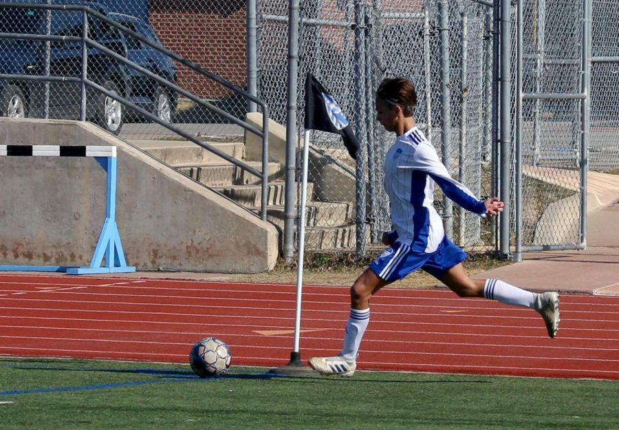 Sophomore Jett Thomson prepares for a corner kick. Thomson is one of three sophomores currently on varsity, after having none last year.