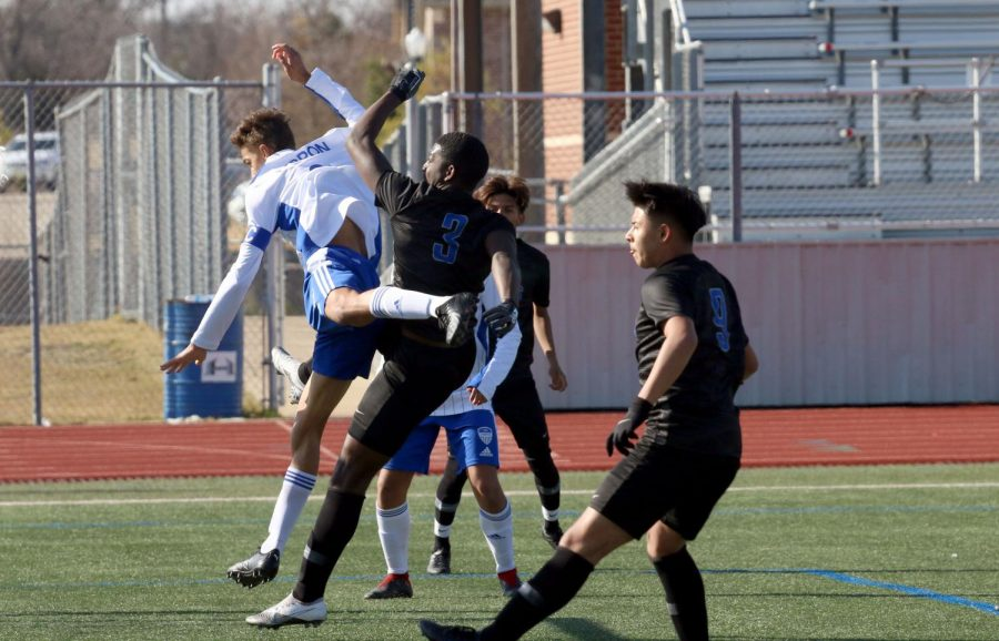 Senior centre back Cayden Casburn collides with a Tyler player during a corner kick. Casburn is one of the team captains and this is his second year on varsity.