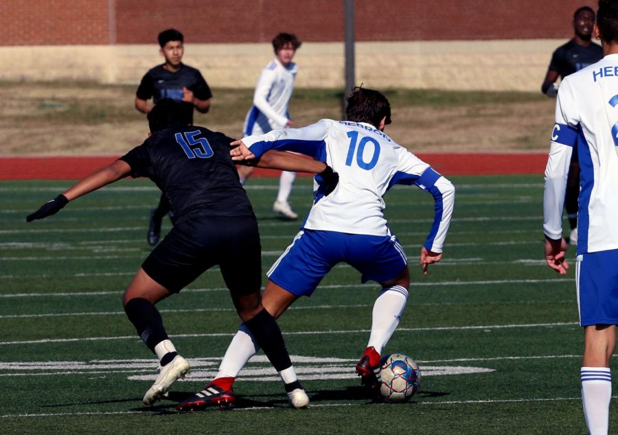 Senior Garrison Hatley pushes a Tyler player away in order to maintain control of the ball. Hatley has been named one of the team's captains for the 2020-21 season.