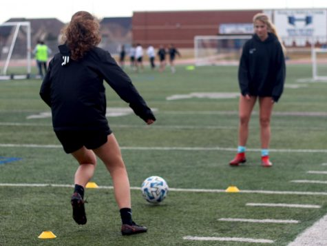 Juniors Rylan Rolich and Weslyn Brown work on passing drills at Wednesday practice. Girls soccer has completed preseason and is going into district play with five wins and one loss.