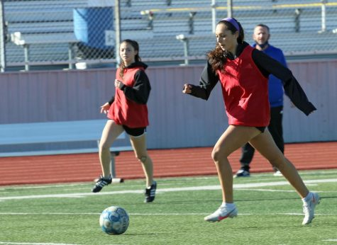 Senior Matilda Torres runs with the ball toward the goal during practice on Feb. 4. The team was divided into two groups and had scrimmages to practice their techniques.