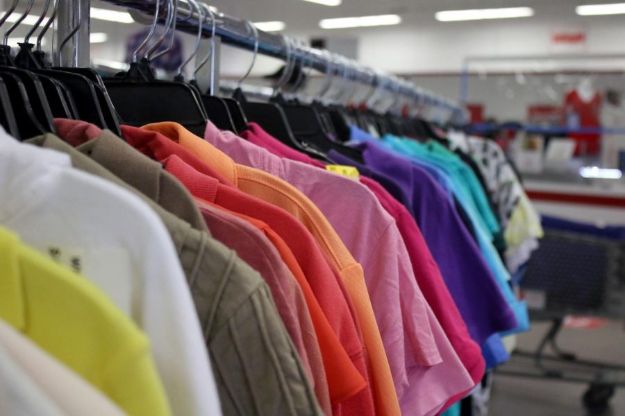 Clothes hang on a rack at a Salvation Army store. The Salvation Army collects clothing, furniture, household appliances and other items that can be resold.