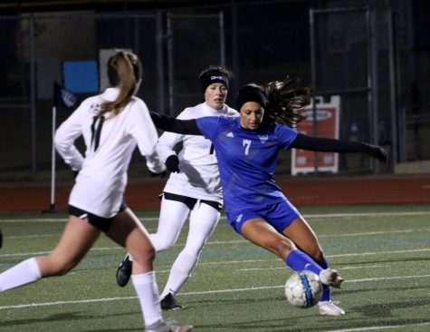 Senior forward Matilda Torres traps the ball to keep it away from the opponent. Torres has scored a total of two goals this season.
