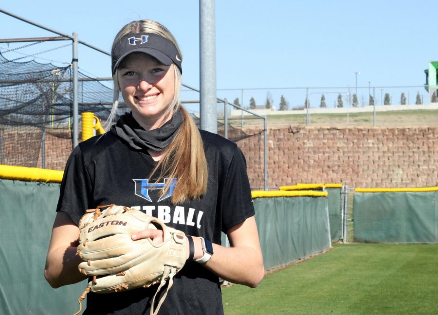Senior+Riley+Nicholson+poses+outside+the+softball+field+with+her+glove.+Nicholson+has+been+playing+softball+for+the+last+8+years+and+has+committed+to+play+in+college+too.