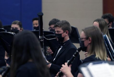 Freshman Jake Johnson plays his bassoon during the mid-winter concert on Feb. 26. Johnson performed with the concert band, led by assistant band director Zack Anderson.