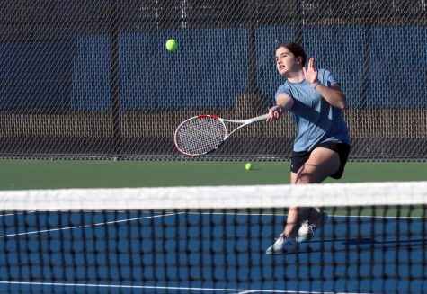 Freshman Macie Snyder hits a forehand approaching shot. She is currently the only freshman on the varsity team.