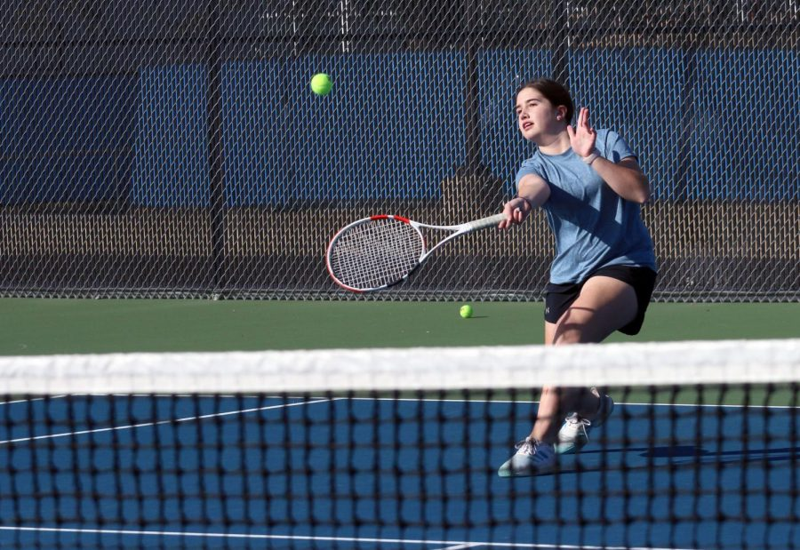 Freshman+Macie+Snyder+hits+a+forehand+approaching+shot.+She+is+currently+the+only+freshman+on+the+varsity+team.+