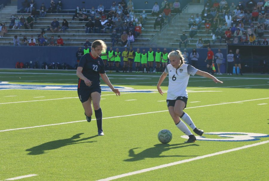 Junior Chloe Jones dribbles around an Allen defender to begin a counter attack against Allen's defense. This happens when the attack has more players than the defense.