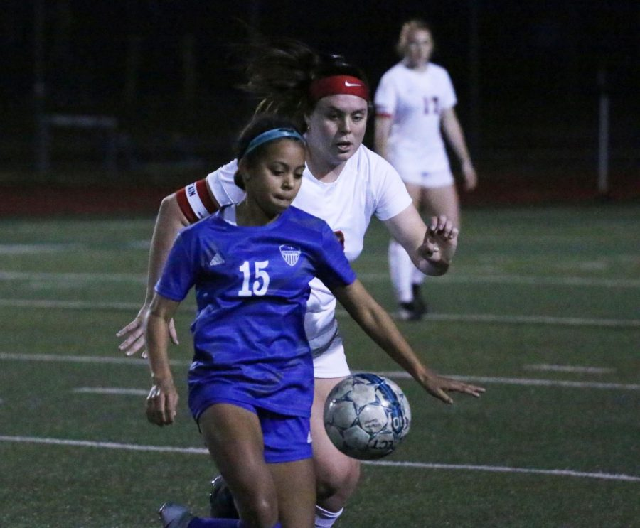 "Sophomore forward Aryanna Jiminson blocks the ball from the opponent. Jiminson scored the first goal in the game. ""That's how we try to play,"" head coach Bobby Vaughn said. ""We stay on the sidelines and encourage them about how they need a run to start the game strong."""