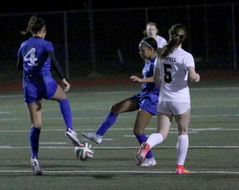 Sophomore forward Aryanna Jiminson and senior forward Taylor Cheatham pass the ball to each other during their game against Coppell. The team is currently ranked fourth in the district.