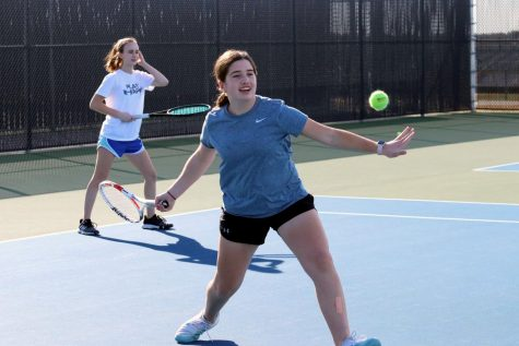 Freshman Macie Snyder hits a forehand return during practice. Snyders doubles partner is junior Abby Lux and they have placed in multiple tournaments.