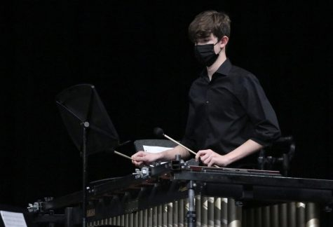 Senior Tyler Kerch performs with an ensemble at the percussion concert on March 9. Percussionists are required to play a variety of instruments, including marimbas, snares, chimes, timpanis and more.