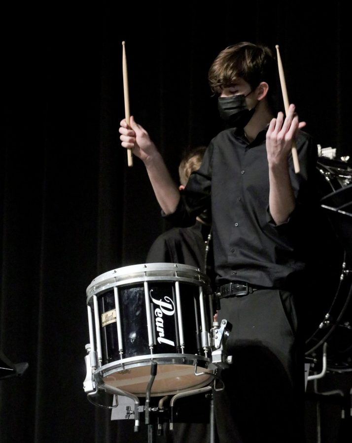 Kerch plays on a snare drum during the percussion concert on March 9. Kerch was the 2020-21 snare captain, a part of the drumline leadership team.