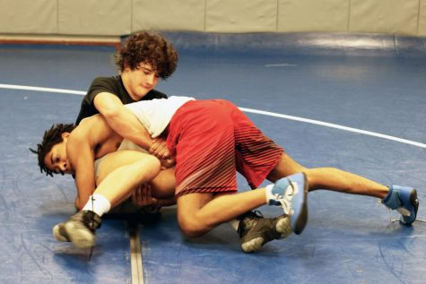 "Sophomore Graham Hatley and sophomore Kason Mitchell wrestle during morning practice. Assistant coach Austin Kaehn said the team is very young this year. ""I'm proud of these first year guys for coming out and battling,""  Kaehn said."
