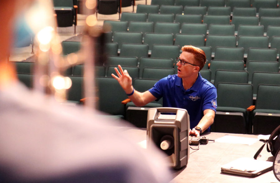 Assistant band director Brock Alsaffar instructs the trumpets and mellophones during class on Aug. 31. Alsaffar works with all high brass players across the program, regardless of which class period they're placed in.
