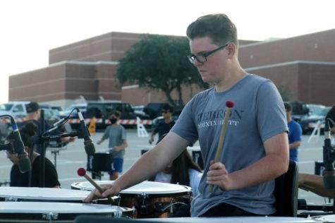 Senior Ethan Watson plays timpani during morning rehearsal on Sept. 17.