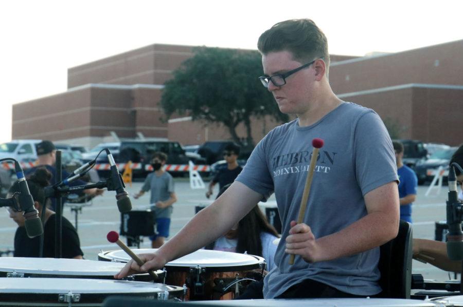 Senior+Ethan+Watson+plays+timpani+during+morning+rehearsal+on+Sept.+17.