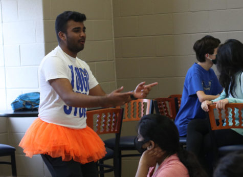 Junior Asil Mithani talks about red ribbon week ideas during YouGo StuCo. Mithani led a discussion about possible dress up days and other ways for members to earn points.