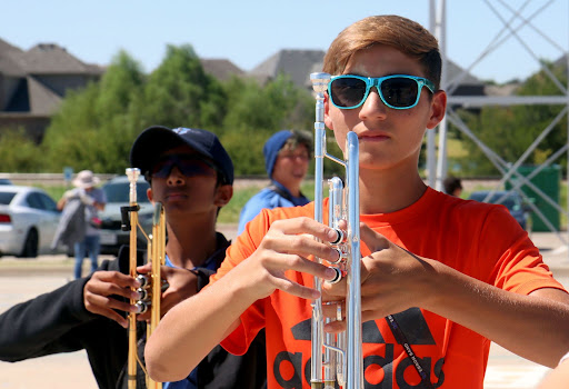 Sophomore Jack Strahan and freshman Nikhil Pimpalapure march during class on Sept. 22. Volunteers for the food drive will collect donations next to the Hebron Band trailer, which is parked outside of the band hall and auditorium.