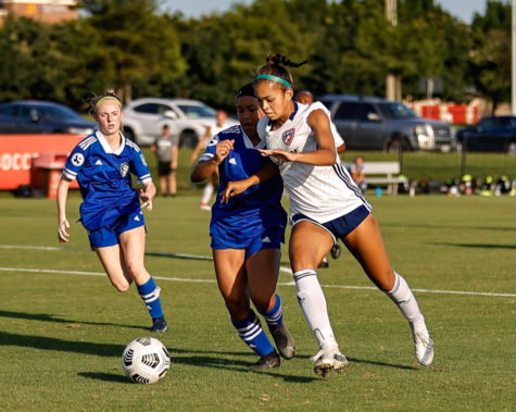 """Junior Taylor Cheatham races against the other team to get the ball. On top of playing as forward for the Hebron Women's soccer team, she is also a forward for F.C. Dallas. """"[The thing that has kept me in soccer] is the feeling after playing -- not necessarily playing a good game, but the feeling of accomplishment after running super hard and having an overall good game,"""" Cheatham said."""