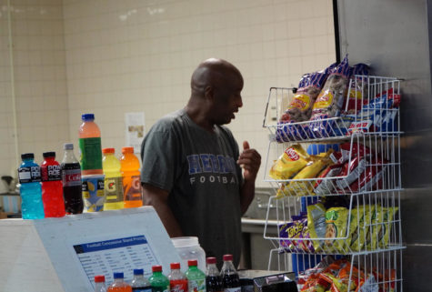 Ulysses Wright, the head of the Hebron football concessions, provides snacks and drinks to customers at the Hawk Stadium on Oct. 7.