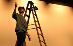 """Senior Asad Bhimani rehearses a scene in Act II of """"Our Town."""" The show will be performed at 7 p.m. on the Thursday, Friday and Saturday night performances along with a Saturday matinee at 2 p.m."""