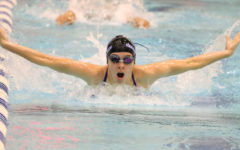 Sophomore Avery Gallucci practices butterfly during morning practice on Oct. 14. The team implements dryland workouts as well as swimming into their daily training.