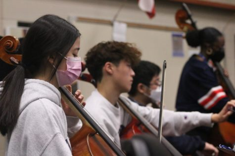 Karis Moon, a junior chamber orchestra student, practices her cello during third period. The chamber students prepare for the cluster concert on Oct. 14 by practicing the songs they will perform.