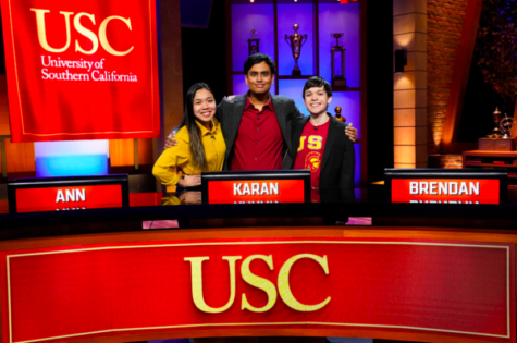 """2019 alumnus Brendan Glascock (right) poses with Karan Menon and Ann Nguyen on the set of Capital One's """"College Bowl."""" Glascock attends the University of Southern California and is a computer science major. """"College Bowl"""" is currently streaming on Hulu."""