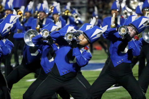 Seniors Alan Nam and Allison Anders play the trumpet during halftime. Seniors were pinned with a red rose boutonniere prior to the game for the band's senior night.