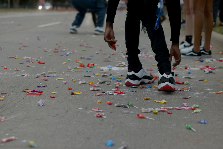 Candy lies on the streets surrounding Hebron as the parade concludes. Following this event, a community pep rally was held in the Hawk Stadium for community members to see what the student pep rallies are like.