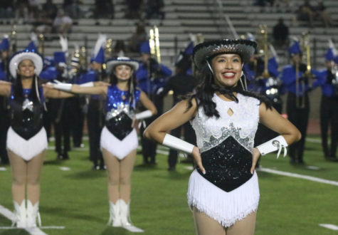 Junior Lieutenant Marielle Bustamante smiles at the crowd during the Silver Wings halftime performance during the Sept. 24 home game.