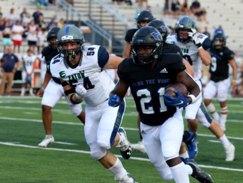 Running back Fred Ware runs the ball against Eaton at the Sept. 10 home game.